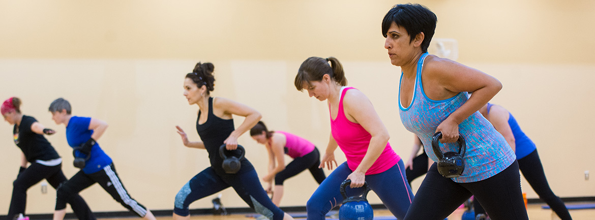 Group of people in kettlebell class