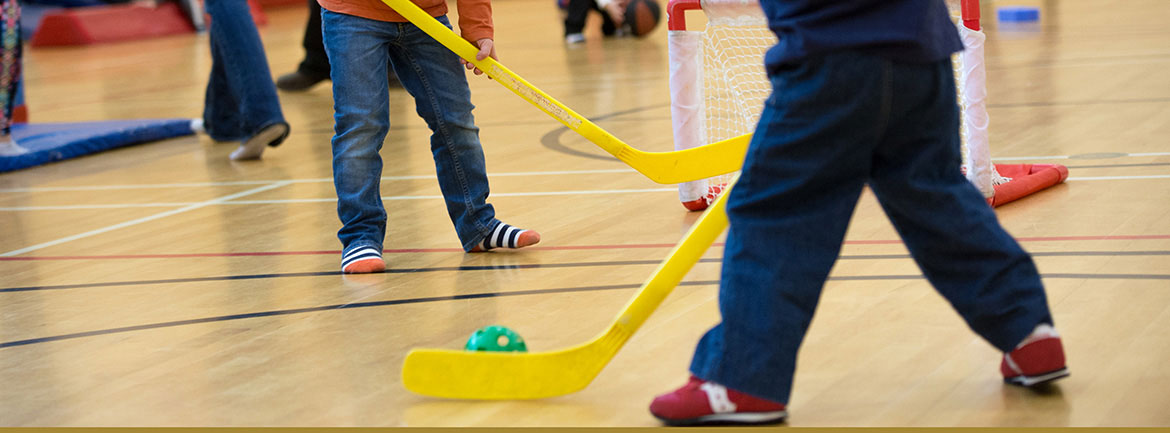Children playing floor hockey