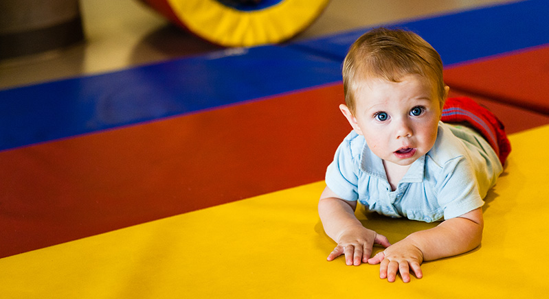 baby on a brightly coloured mat