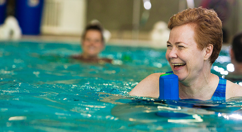 woman in aquafit class with two others