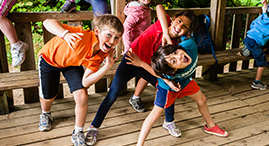 Kids having fun at a YMCA summer camp.