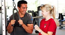 A YMCA personal trainer works with a client.