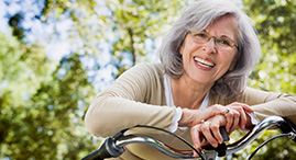 A senior woman on a bicycle.