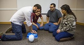Youth learning CPR