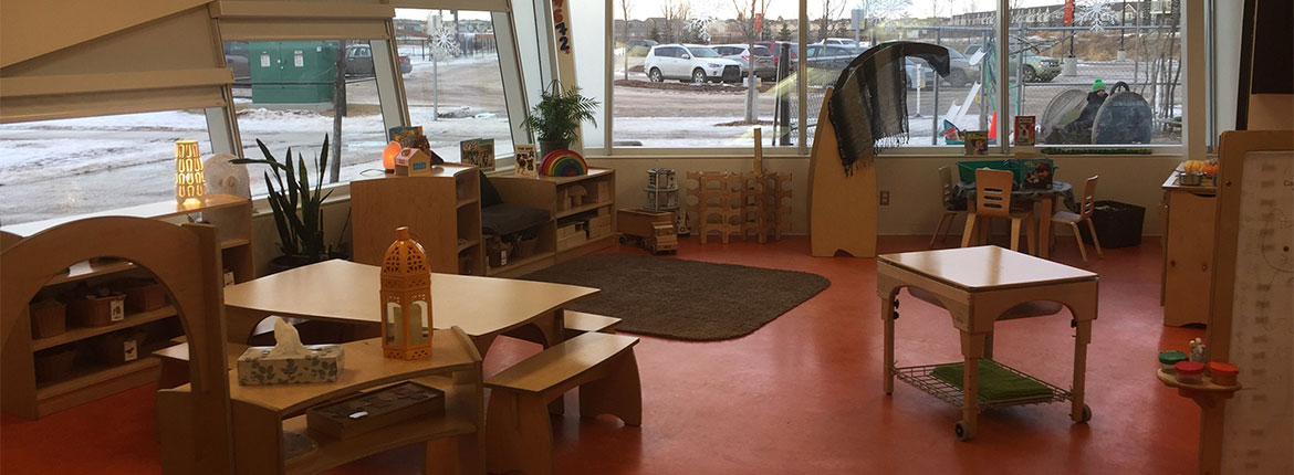 Child Care Centre, surrounded by windows with a view to parking lot, sectioned off with different areas of activities