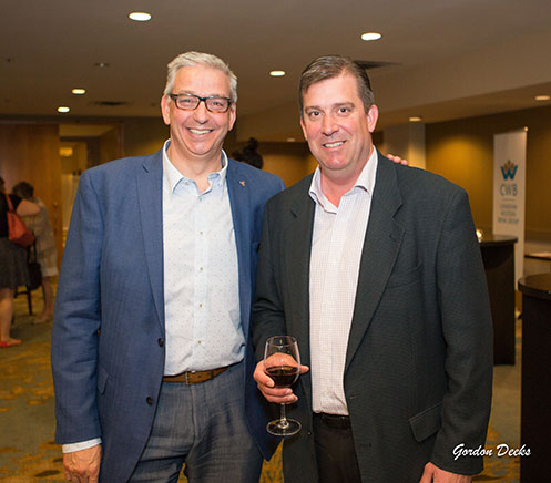 Golf-reception-and-silent-auction-YMCA-of-Northern-Alberta-President-and-CEO-Nick-Parkinson-pictured-with-John-Kopeck