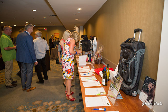 Golf-reception-and-silent-auction-attendees-checking-out-some-auction-items