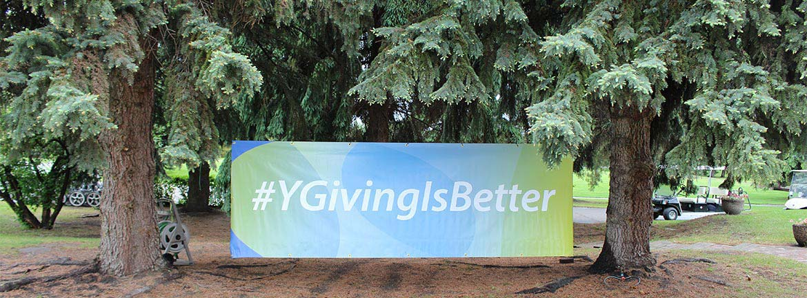 YGivingIsBetter Banner tied to trees